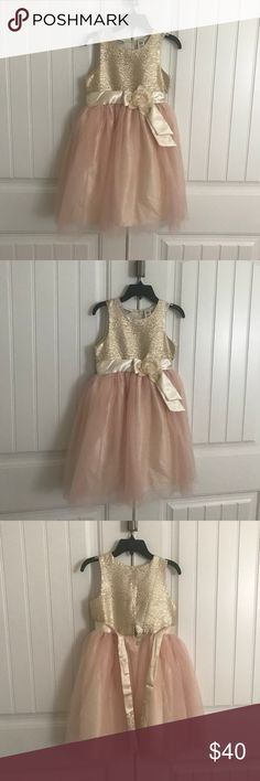 new with tags beautiful girls dress Brand new with tags  Beautiful girls dress in size 10   All my items come from a pet free smoke free home  Fast shipping  Same day or next day depending on time of purchase Dresses Formal