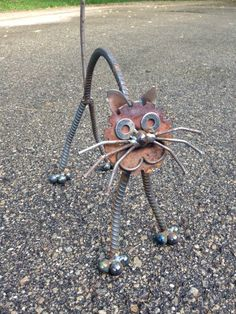 Its amazing how much we throw away that still has a useful life. Taking old metal utensils, golf clubs, tools and odds & ends, Jim welds a creative creature or art piece to use in the garden.  This cat is unique in size but usually is 16 long by 12 tall. Tail bobbles in the wind. A great gift for a cat or animal lover.  We ship out next business day after order is placed. Shipping times vary by location but usually take between 2-7 business days via USPS or Fedex. If you should want 2 ite...