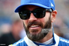 Jimmie Johnson, driver of the #48 Lowe's Chevrolet, stands on the grid during the Monster Energy NASCAR Cup Series Auto Club 400 at Auto Club Speedway on March 26, 2017 in Fontana, California.