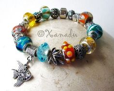 Tropical Island Vacation European Style Charm Bracelet - Turquoise, Teal, Orange Lampwork Glass Beads And Silver Ocean Themed Animal Charms. $31.95, via Etsy.