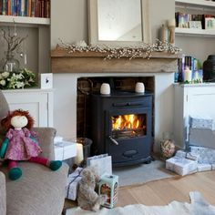 Cosy living room wood burner and love the fitted cupboards either side of the chimney breast Living Room Photos, New Living Room, Home And Living, Living Room Decor, Small Living, Foyers, Style At Home, Cosy Living, Living Room Inspiration