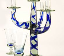 4 Arm Candelabra and goblets by Ngwenya Glass. handmade and Recycled!