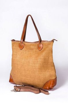 Straw and leather shoulder bag from Vive la difference (available at Brussosa)