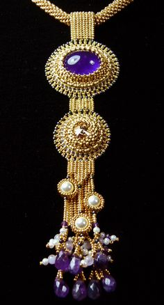 "November 2012 - The third in my trilogy ""gold"" cabochon amethyst, swarovski rivolis: 6mm, 11 and 15 miyuki rocaille gold plated toho No. 11, swarovski pearl 6mm beads and drops of amethyst, freshwater pearls, crocheted torque, bo gold plated."