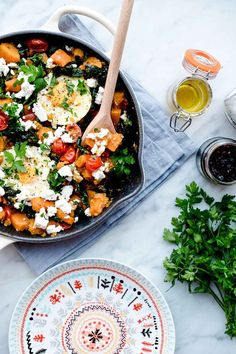 """Sweet Potato and Kale Hash with Poached Eggs and Feta Cheese cooked in Le Creuset cast iron pan in """"dune almond"""" colour Sweet Potato Kale, Sweet Potato Recipes, Egg Recipes, Brunch Recipes, Breakfast Recipes, Eggs And Kale, Vegetarian Recipes, Healthy Recipes, Healthy Comfort Food"""