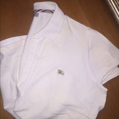 Burberry polo tee A little yellow in some spots not noticeable but 100% authentic Burberry Tops Tees - Short Sleeve