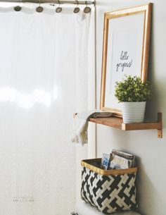 Add art to the bathroom! Try a minimal floating shelf with art & some accessories over the toilet to add visual interest.