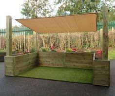 Provide an area outside protected from sun and drizzle where small groups of children can play together with our sensory cosy garden.