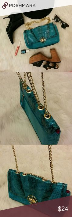 """Kate Landry Street Style Purse Snake skin print faux leather. Zipper pouch in back and inside with cell phone holder inside. Measures 11 1/2"""" long 6 1/2"""" deep. Chain 44"""" long. Kate Landry Bags Clutches & Wristlets"""