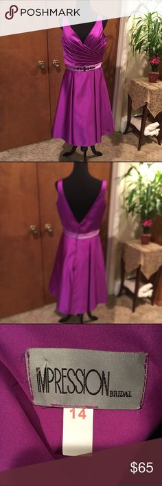 "Impressions Bridesmaid /Party dress This dress is a beautiful color of purple. It has black beads at the waist. The measurements are laid flat for the bust is 18"" and fir the length from arm to hem is 31"". Impressions Dresses Midi"
