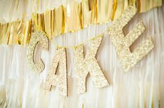 Show 'em where the cake's at with this cheeky glitter banner.