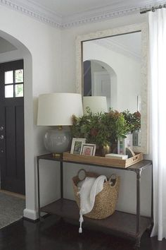 Entry Room Furniture easy decorating with palm fronds, branches and greenery | console
