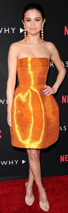 Who made  Selena Gomez's orange earrings, strapless dress, and white mule sandals?