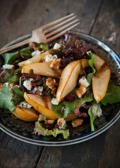 Roasted Pear and Gorgonzola Salad, with Balsamic Vinaigrette   Let me introduce you to my new favorite lunch combo. Warm roasted pears, salty gorgonzola cheese, toasted walnuts, and dried cranberries (or cherries), all brought together with some fresh arugula and spinach, and a drizzle of balsamic vinaigrette.