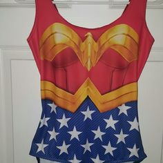 Blackmilk Wonder Woman Swimsuit Only worn 1x (as a bodysuit). Comes with cape that attaches at the shoulders via buttons. Fits true to size. Blackmilk Swim One Pieces