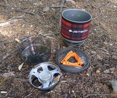 The Jetboil MiniMo Personal Cooking System includes a cook pot, measuring cup, stove stand, lid with strainer, canister fuel stand, and a burner that can simmer meals in additionto providing a full on boil.