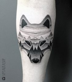 Abstract wolf tattoo with mountains