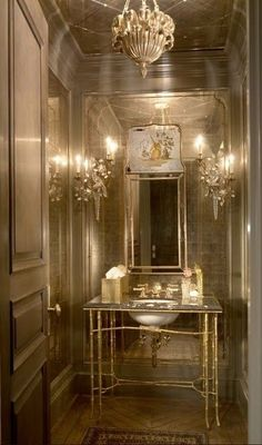 A fun over-the-top mirrored powder room for your enjoyment!  I think the gorgeous crystal sconces are from Paul Ferrante (or they look very similar to sconces in their line).