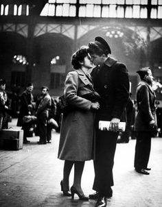 """A sailor and his girl stand close to each other, lips scarcely touching. He has been overseas and has come back, but this goodbye is no easier than any of the others."""" Penn Station 1943 #wwii"""