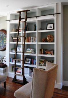 I'd love to have a rolling ladder and this kind of shelving in our study.  Awesomeness!!