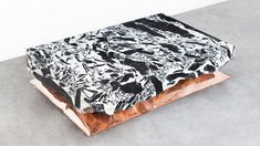 """Belgian designer Ben Storms placed huge blocks of marble on top of inflated metal """"pillows"""" to create this range of coffee tables, exhibited at this year's Collectible design fair."""