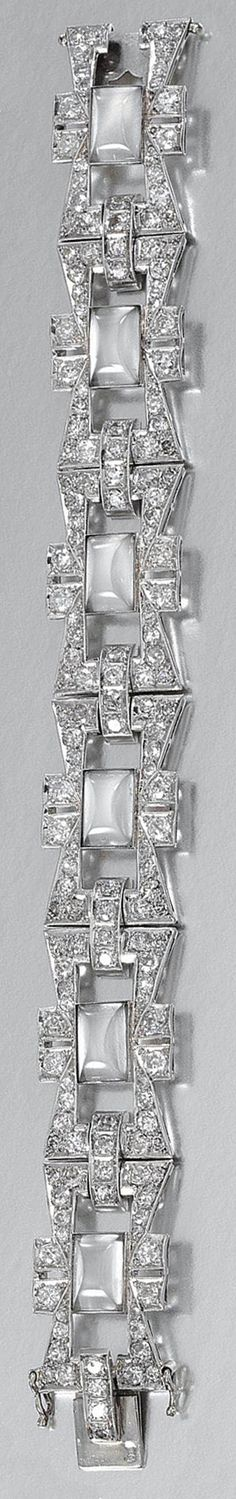 MOONSTONE AND DIAMOND BRACELET, CIRCA 1925.  Designed as a series of open work links, millegrain-set with circular-cut diamonds, decorated at the centre with cabochon moonstones, length approximately 175mm, French assay marks, composite.