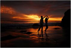Dance on the beach at sunset with the love of my life.