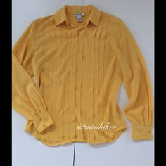 """Vintage Christian Dior Yellow Blouse This is a beautiful yellow that I can't capture in photos 100% Authentic Christian Dior  Beautiful tucking and covered front placket  Excellent vintage condition. Very slight puckering on the cuffs  100% polyester  Bust 40""""; length 26""""  Smoke free home  Christian Dior Tops Blouses"""
