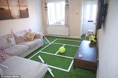 Anyone for tennis: The couple, who live in a three-bedroom house in Derbyshire, ensured that if rain stops play during the competition in SW19, they will be able to play a match in the comfort of their home