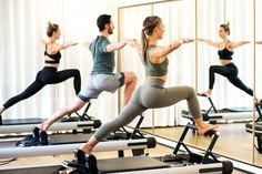 Class in a gym doing pilates standing lunges #paid, , #affiliate, #AD, #gym, #lunges, #standing, #Class Gym Mirror Wall, Gym Mirrors, Pilates Studio, Pilates Reformer, Pilates Equipment, Studio Equipment, Best Abdominal Exercises, Types Of Cardio, Photo Class