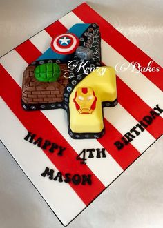 No. 4 Superheroes birthday cake with a Hulk fist, Captain America shield, Thor hammer and Iron Man mask