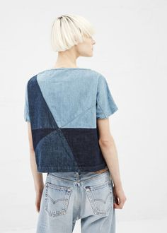 Short-sleeved, boatneck top with dropped shoulders cut full in a light blue, navy and washed black stretch cotton denim. Geometric patchwork pattern throughout in different denim washes. Hand wash cold, and lay flat to dry, or dry clean.
