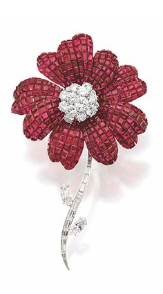 INVISIBLY-SET RUBY AND DIAMOND FLOWER BROOCH, VAN CLEEF & ARPELS, NEW YORK, CIRCA 1965.  The center of the blossom set with a cluster of round diamonds weighing approximately 5.50 carats, the petals invisibly-set with numerous square-cut rubies, the stem set with baguette and tapered baguette diamonds accented with 2 marquise-shaped diamond leaves, weighing approximately 3.00 carats, mounted in platinum, signed Van Cleef & Arpels