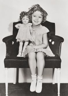 Shirley Temple with her doll. 1936