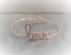Hey, I found this really awesome Etsy listing at https://www.etsy.com/listing/123936828/rose-gold-love-bracelet-sister-gift