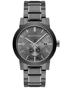 """Burberry's Swiss-made timepiece is a distinguished design with smoky color covering high-grade steel. 
