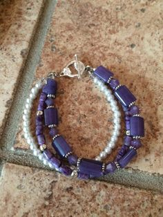 Gorgeous 3 strand purple bracelet with jade, sugalite, and glass pearls by RealBeadDesigns on Etsy