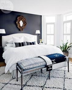 """""""Decorating one room completely and then carrying that look to the next allows you to really establish a cohesive aesthetic throughout the house,"""" says Melanie, who started with the living room and finished with the master bedroom, which echoes the rest of the home's light-meets-dark and modern-meets-traditional themes. #BeddingMasterBedroom"""