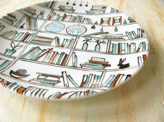 Decorative hand drawn and painted porcelain plate - Book-A-Holic - Mint blue and brown. £15.00, via Etsy.