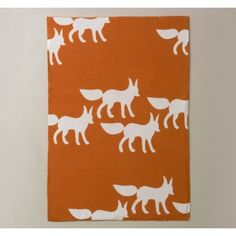 AH!! How about a fox themed room? There are so many cute fox things out for kids. Picture this: a warm tan wall color, copper, brown, butterscotch accents.... maybe light blue curtains.