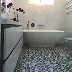 The SomerTile 9.75x9.75-inch Art Grey Porcelain Floor and Wall Tile features a gorgeous, geometric pattern in a combination of grey-green hues. Combine these tiles for a uniform design in your living
