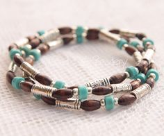 Turquoise Stretch Bead Stack Bracelet Trio with Dark Brown and Tibetan Silver and Silver Plated Beads on Etsy, $19.50