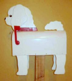 Bichon mailbox - Handcrafted and hand painted animal mailboxes by artist Michel Devost in Quebec. If you would like to order a special mailbox, contact Michel at http://pages.globetrotter.net/miche/mailboxes.html