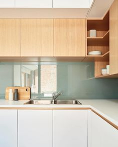 Kitchen, Wood Cabinet, Drop In Sink, and White Cabinet Connect Parkville House kitchen.  Photo 184 of 2157 in Best Kitchen Photos from 10 Best Architects to Follow on Instagram Right Now