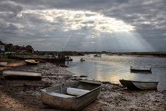 God rays over Burnham Overy Staithe harbour.