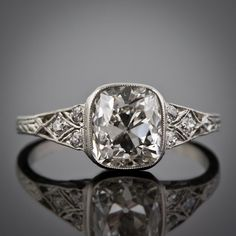 A carat antique cushion cut diamond shines in this Art Deco diamond engagement ring. At Lang Antiques. The band this is on is gorgeous. If like to see a sapphire or emerald as the center stone instead of a diamond, though. Antique Rings, Antique Jewelry, Vintage Jewelry, Vintage Rings, Vintage Art, Art Deco Jewelry, Fine Jewelry, Jewelry Design, Jewelry Rings