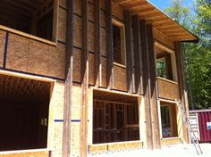 Instead of using Larsen trusses, the house used vertical TJIs (I-joists) to hold enough insulation to bring the wall assembly to about R-52. The TJIs were screwed to the 2x4 studs through the exterior OSB sheathing.