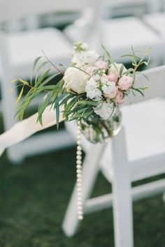 Unique pastel wedding ceremony aisle marker idea - Pastel pink, white and cream + greenery flower arrangements + pearl strands {Elizabeth Fogarty}