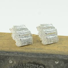 Love these sparkling silver bark stud earrings!  $67