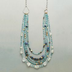 """BRASSY BLUES NECKLACE -- Brass buttons punctuate our collection of apatite, turquoise, aquamarine, lapis and garnet, each strand different from the next. Our exclusive, multi-strand gemstone necklace is handcrafted with 14kt white vermeil links that slip on overhead. 28""""L."""